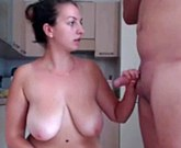 Busty brunette get fucked in the kitchen in front of webcam
