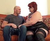 Plump redhead fuck with bald man on couch