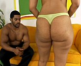 Black bitch in green bra and fat ass is sucking huge black dick on the sofa