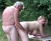Young busty blonde fucks in the woods with old man