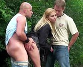 Public Banging – Cute woman gets cum on her face by two guys in the outdoor group sex
